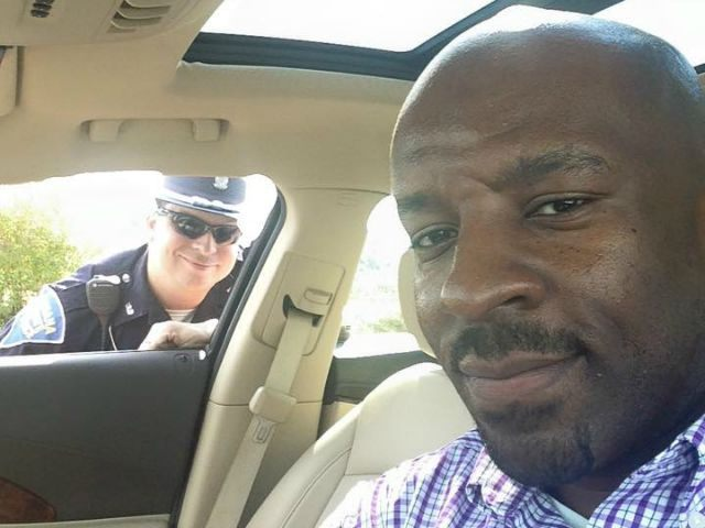 Greg-Barnes-Jr-and-cop-selfie-Facebook