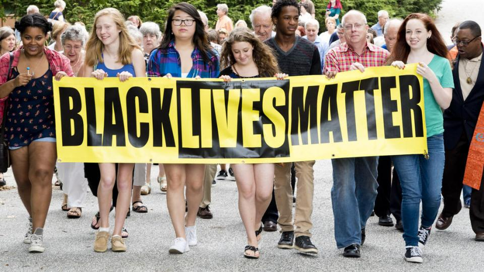 Digital Afro youth_carry_blm_banner_from_news_article